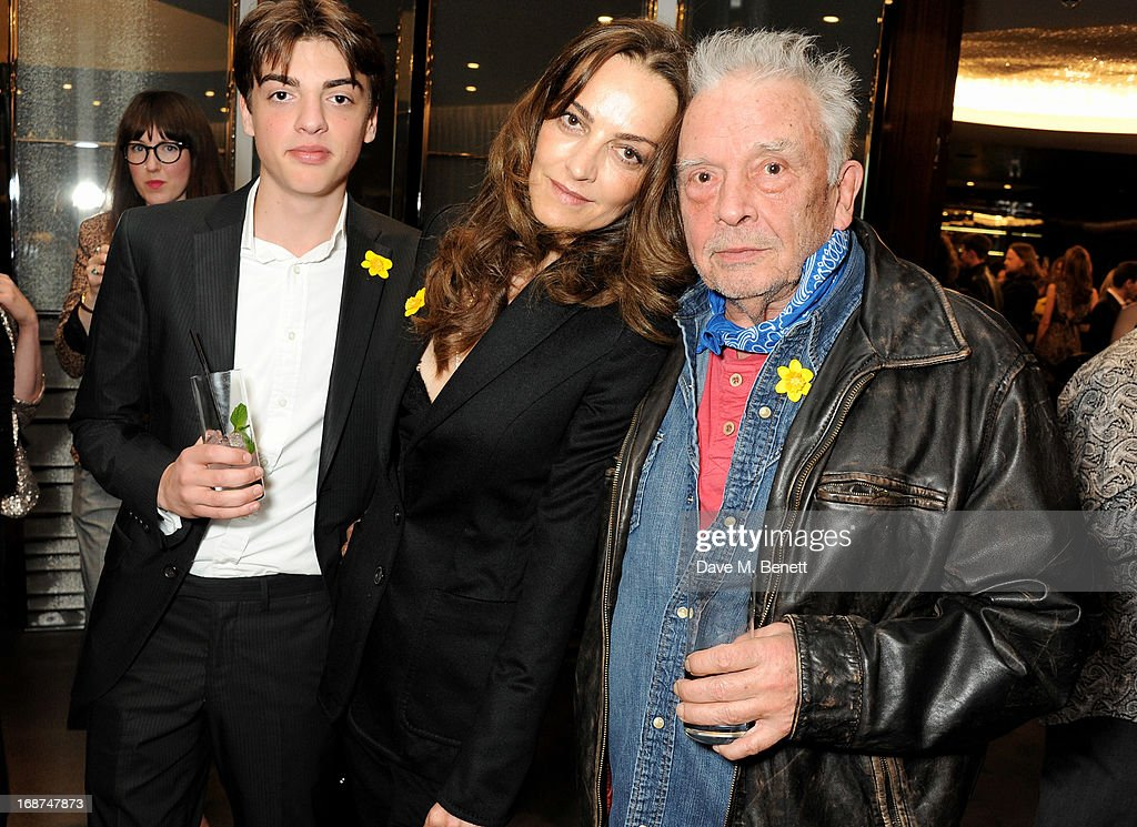 Sascha Bailey, <a gi-track='captionPersonalityLinkClicked' href=/galleries/search?phrase=Catherine+Bailey&family=editorial&specificpeople=242863 ng-click='$event.stopPropagation()'>Catherine Bailey</a> and David Bailey attend the launch of Samsung's NX Smart Camera at a charity auction with David Bailey in aid of Marie Curie Cancer Care at the Bulgari Hotel on May 14, 2013 in London, England.
