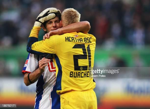 Sascha Burchert and Levan Kobiashvili of Berlin celebrates after the Bundesliga match between VfL Wolfsburg and Hertha BSC Berlin at the Volkswagen...