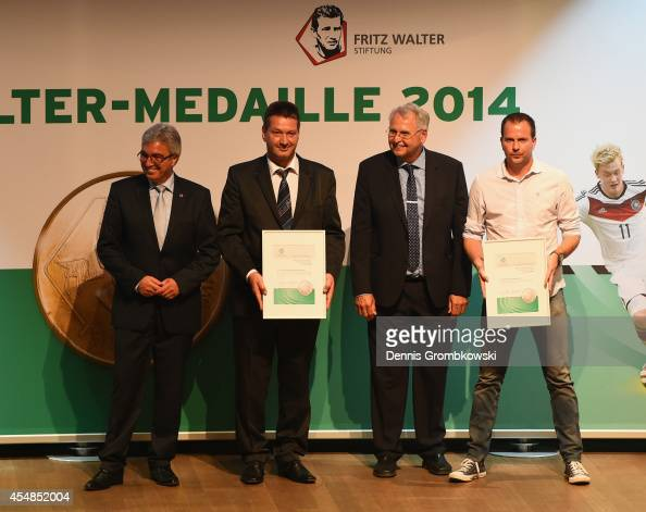 Sascha Lewandowski takes the medal for Levin Oeztunali who is honored with the U18 Fritz Walter Medal in silver at the Fritz Walter Medal Awarding...