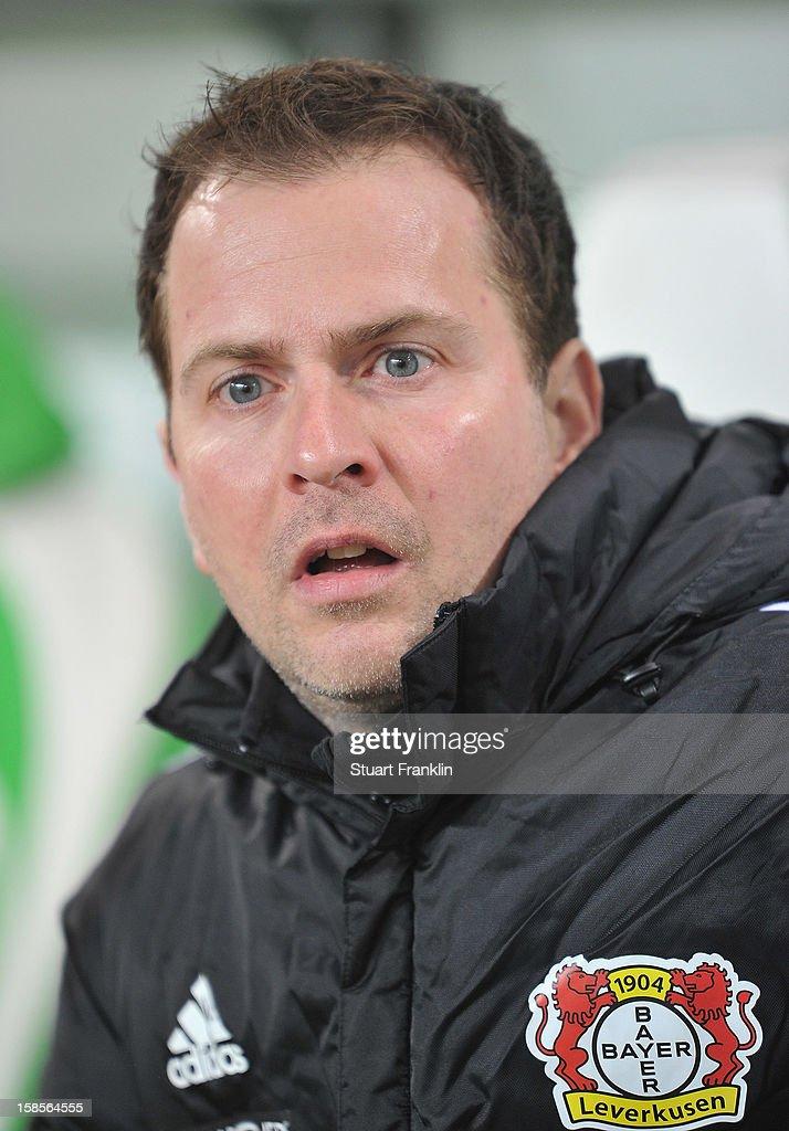 Sascha Lewandowski, trainer of Leverkusen ponders during the round of 16 of the DFB cup match between VfL Wolfsburg and Bayer Leverkusen at Volkswagen Arena on December 19, 2012 in Wolfsburg, Germany.