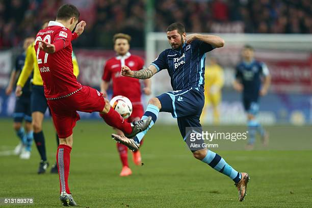 Sascha Moelders of 1860 Muenchen is challenged by Stipe Vucur of Kaiserslautern during the Second Bundesliga match between 1 FC Kaiserslautern and...