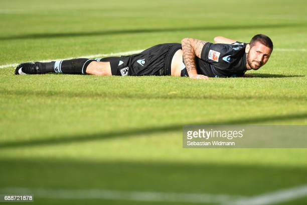 Sascha Moelders of 1860 Muenchen lies on the pitch after a missed shot during the Second Bundesliga Playoff first leg match between Jahn Regensburg...