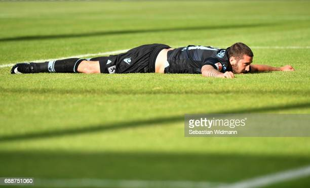 Sascha Moelders of 1860 Muenchen lies on the pitch during the Second Bundesliga Playoff first leg match between Jahn Regensburg and TSV 1860 Muenchen...
