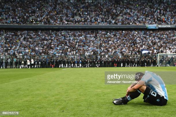 Sascha Moelders of 1860 Muenchen looks dejected after the Second Bundesliga Playoff second leg match betweenTSV 1860 Muenchen and Jahn Regensburg at...
