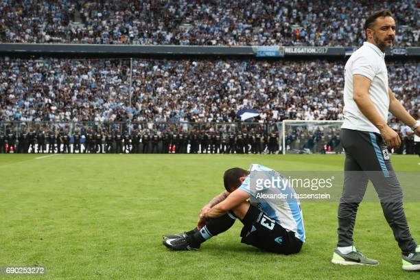 Sascha Moelders of 1860 Muenchen looks dejected with his head coach Vitor Pereira after the Second Bundesliga Playoff second leg match betweenTSV...