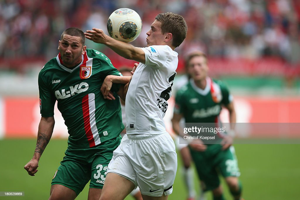 Sascha Moelders of Augsburg and Matthias Ginter of Freiburg go up for a header during the Bundesliga match between FC Augsburg and SC Freiburg at SGL Arena on September 14, 2013 in Augsburg, Germany.
