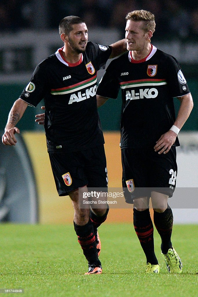 <a gi-track='captionPersonalityLinkClicked' href=/galleries/search?phrase=Sascha+Moelders&family=editorial&specificpeople=4296304 ng-click='$event.stopPropagation()'>Sascha Moelders</a> of Augsburg celebrates after scoring his team's 3rd goal with Andre Hahn of Augsburg during DFB Cup second round match between Preussen Muenster and FC Augsburg at Preussenstadion on September 24, 2013 in Muenster, Germany.