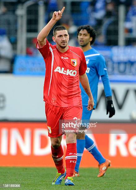 Sascha Moelders of Augsburg celebrates after scoring his teams first goal during the Bundesliga match between TSG 1899 Hoffenheim and FC Augsburg at...