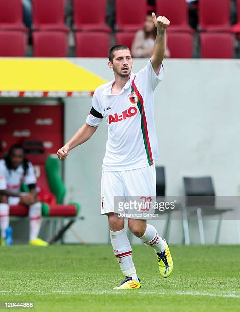Sascha Moelders of Augsburg celebrates after scoring his team's second goal during the Bundesliga matchbetween FC Augsburg and SC Freiburg at SGL...