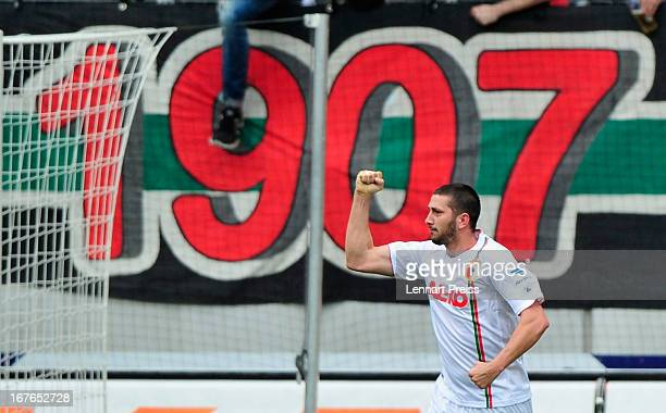 Sascha Moelders of Augsburg celebrates his goal during the Bundesliga match between FC Augsburg and VfB Stuttgart at SGL Arena on April 27 2013 in...