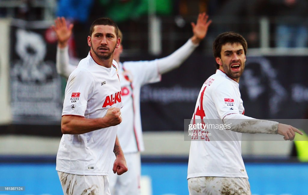 <a gi-track='captionPersonalityLinkClicked' href=/galleries/search?phrase=Sascha+Moelders&family=editorial&specificpeople=4296304 ng-click='$event.stopPropagation()'>Sascha Moelders</a> of Augsburg celebrates his team's first goal during the Bundesliga match between FC Augsburg and 1. FSV Mainz 05 at SGL Arena on February 10, 2013 in Augsburg, Germany.