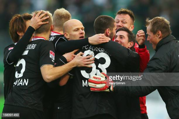 Sascha Moelders of Augsburg celebrates his team's first goal with team mates during the Bundesliga match between SpVgg Greuther Fuerth and FC...