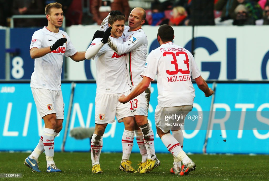 Sascha Moelders (front) of Augsburg celebrates his team's first goal with team mates during the Bundesliga match between FC Augsburg and 1. FSV Mainz 05 at SGL Arena on February 10, 2013 in Augsburg, Germany.