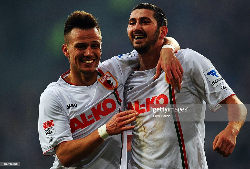Sascha Moelders of Augsburg celebrtaes with team mate Ronny Philip after scoring his teams first goal during the Bundesliga match between Fortuna...