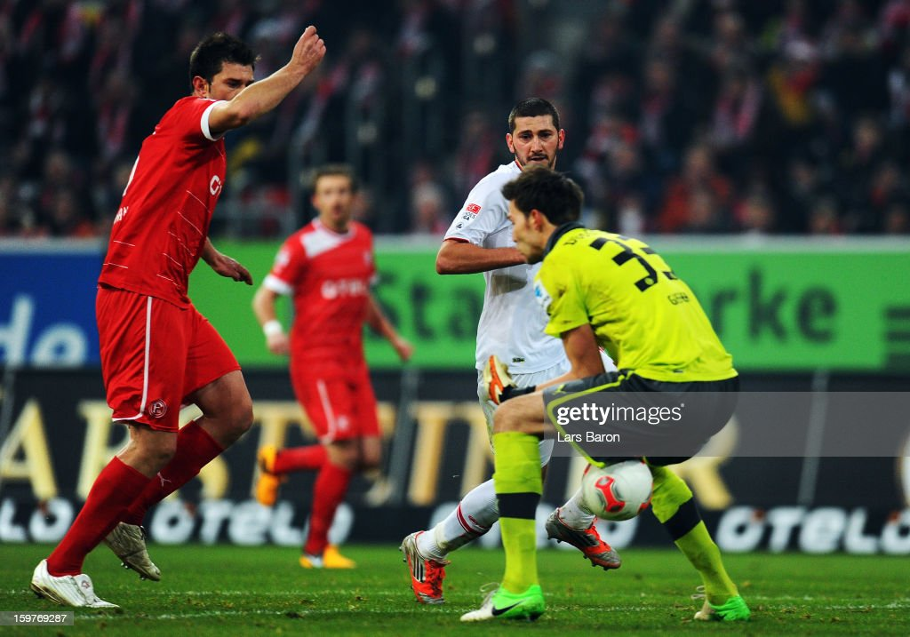 Sascha Moelders of Augsburg is on his way to scores the first goal after goalkeeper Fabian Giefer lost the ball during the Bundesliga match between Fortuna Duesseldorf 1895 and FC Augsburg at Esprit-Arena on January 20, 2013 in Duesseldorf, Germany.