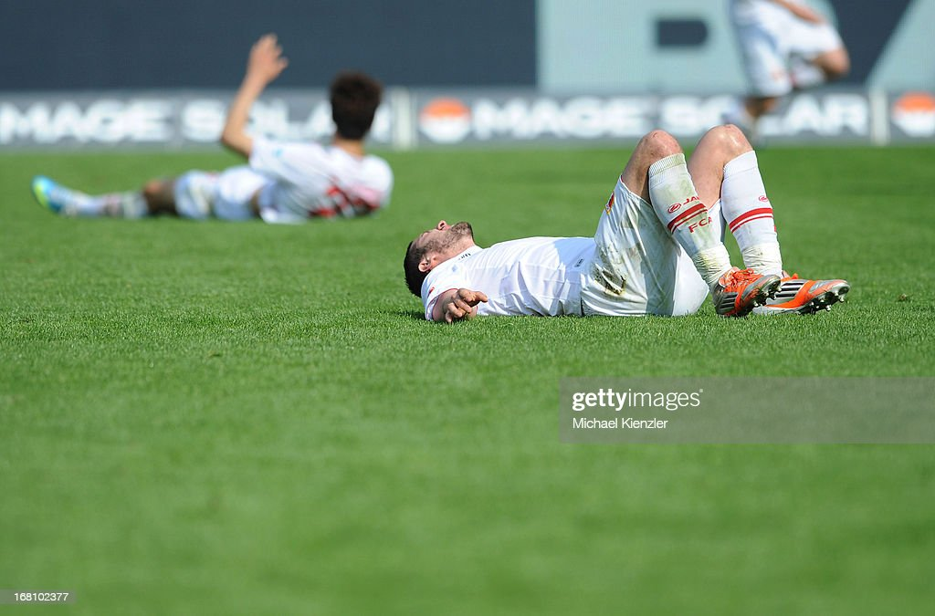 <a gi-track='captionPersonalityLinkClicked' href=/galleries/search?phrase=Sascha+Moelders&family=editorial&specificpeople=4296304 ng-click='$event.stopPropagation()'>Sascha Moelders</a> of Augsburg lies on field during the Bundesliga match between SC Freiburg and FC Augsburg at MAGE SOLAR Stadium on May 5, 2013 in Freiburg, Germany.