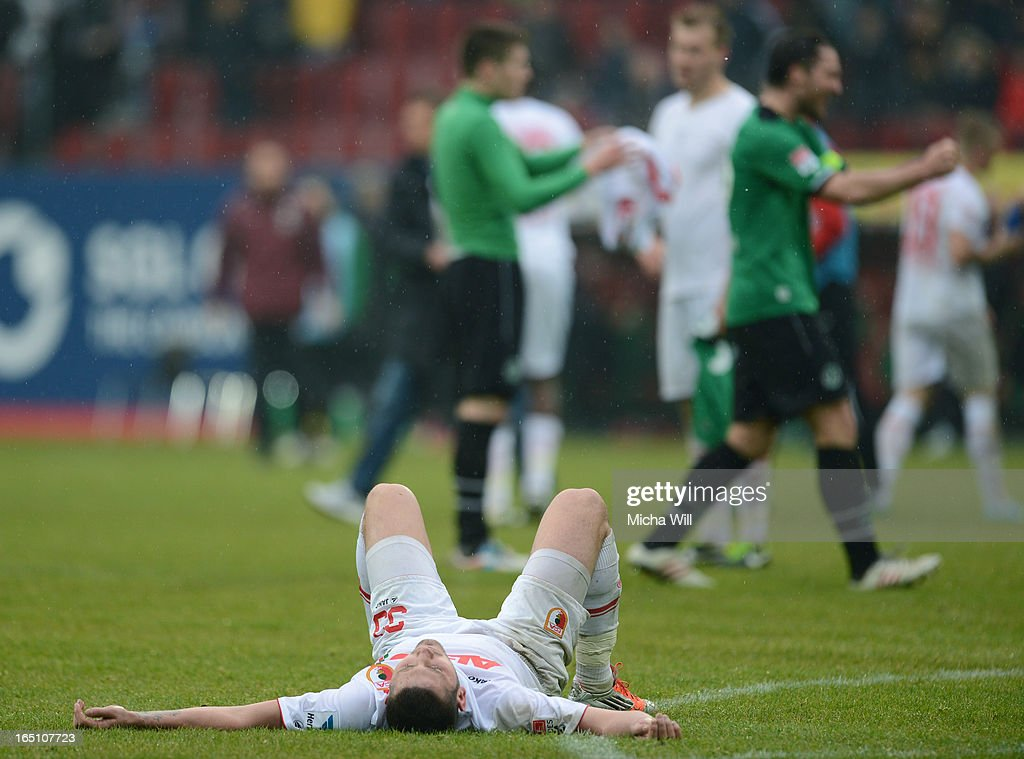 Sascha Moelders of Augsburg lies on the pitch after the Bundesliga match between FC Augsburg and Hannover 96 at SGL Arena on March 30, 2013 in Augsburg, Germany.