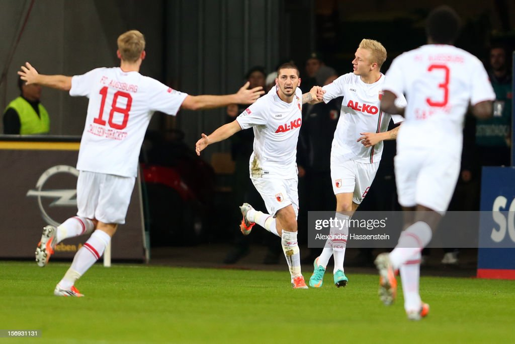 Sascha Moelders (C) of Ausgbsurg celebrates scoring the opening goal with his team mates during the Bundesliga match between FC Augsburg and VfL Borussia Moenchengladbach at SGL Arena on November 25, 2012 in Augsburg, Germany.