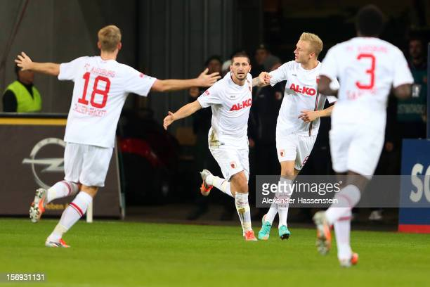 Sascha Moelders of Ausgbsurg celebrates scoring the opening goal with his team mates during the Bundesliga match between FC Augsburg and VfL Borussia...