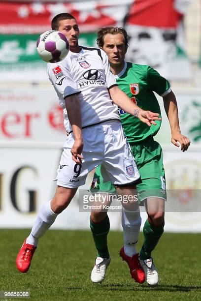 Sascha Moelders of Frankfurt and Jonas de Roeck of Augsburg go up for a header during the Second Bundesliga match between FSV Frankfurt and FC...