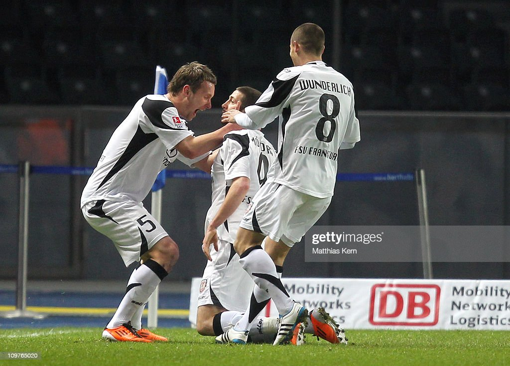 Sascha Moelders of Frankfurt jubilates with team mates after scoring the first goal during the Second Bundesliga match between Hertha BSC Berlin and...