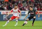 Sascha Riether of Freiburg and Dusan Svento of Cologne fight for the ball during the Bundesliga match between 1 FC Koeln and SC Freiburg at...