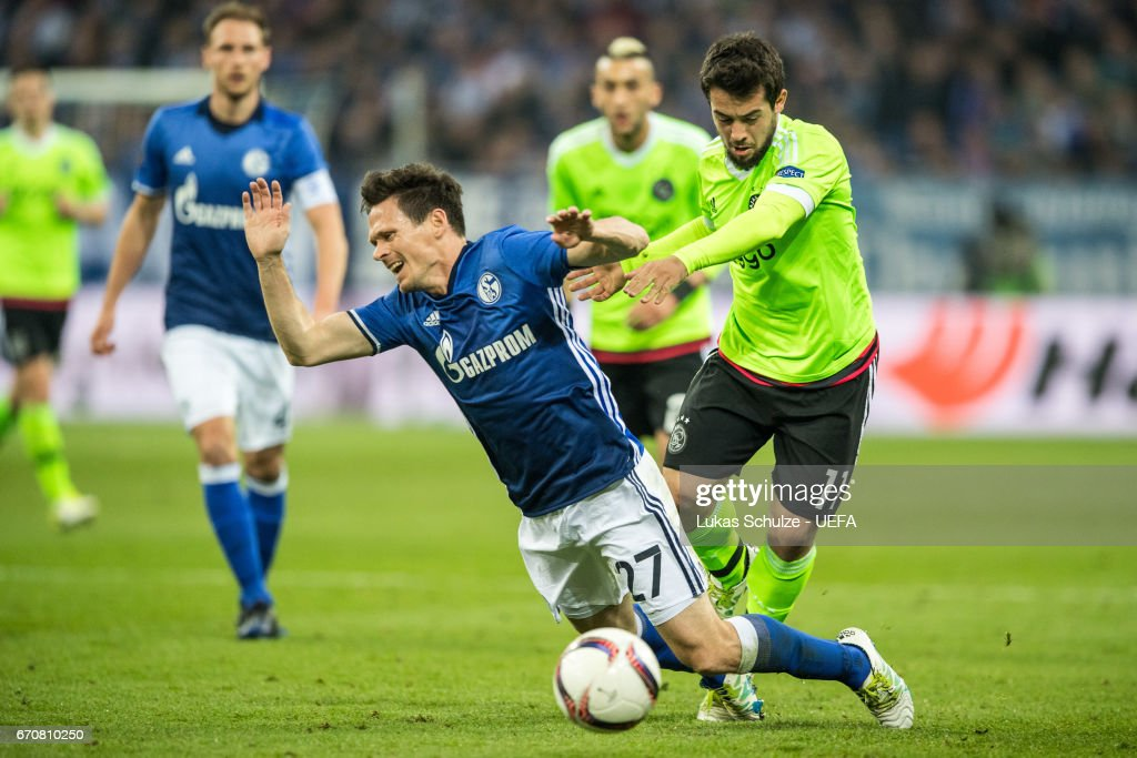 Sascha Riether (L) of Schalke and Amin Younes (R) of Amsterdam in action during the UEFA Europa League quarter final second leg match between FC Schalke 04 and Ajax Amsterdam at Veltins-Arena on April 20, 2017 in Gelsenkirchen, Germany.