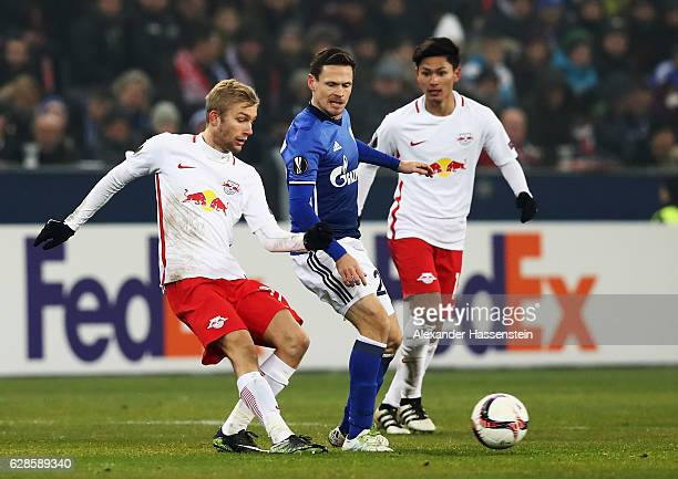 Sascha Riether of Schalke is challenged by Takumi Minamino of Salzburg during the UEFA Europa League match between FC Salzburg and FC Schalke 04 at...