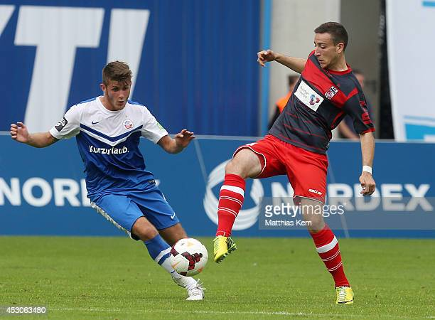Sascha Schuenemann of Rostock battles for the ball with Kevin Moehwald of Erfurt during the third league match between FC Hansa Rostock and Rot Weiss...