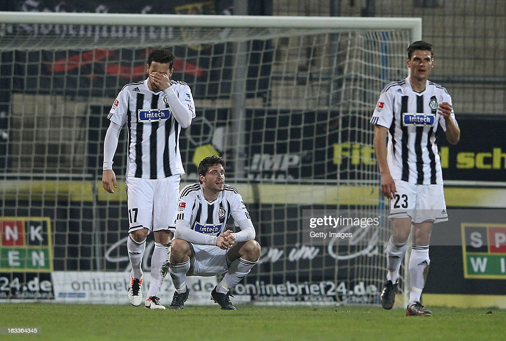 Sascha Traut, Tim Kister and Andreas Hofmann of Aalen react during the Second Bundesliga match between FSV Frankfurt and VfR Aalen at Frankfurter Volksbank Stadium on March 8, 2013 in Frankfurt am Main, Germany.
