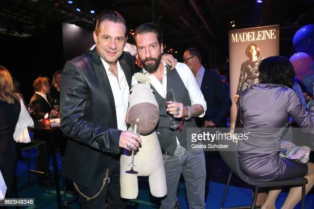 Sascha Vollmer and Alec Voelkel singer of the band 'Boss Hoss' during the 'Tribute To Bambi' gala at Station on October 5 2017 in Berlin Germany