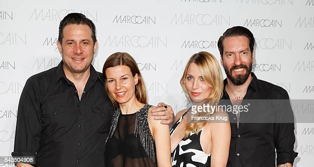 Sascha Vollmer his partner Jenny Alec Voelkel and his wife Johanna Michels attend the Marc Cain fashion show spring/summer 2017 at CITY CUBE Panorama...