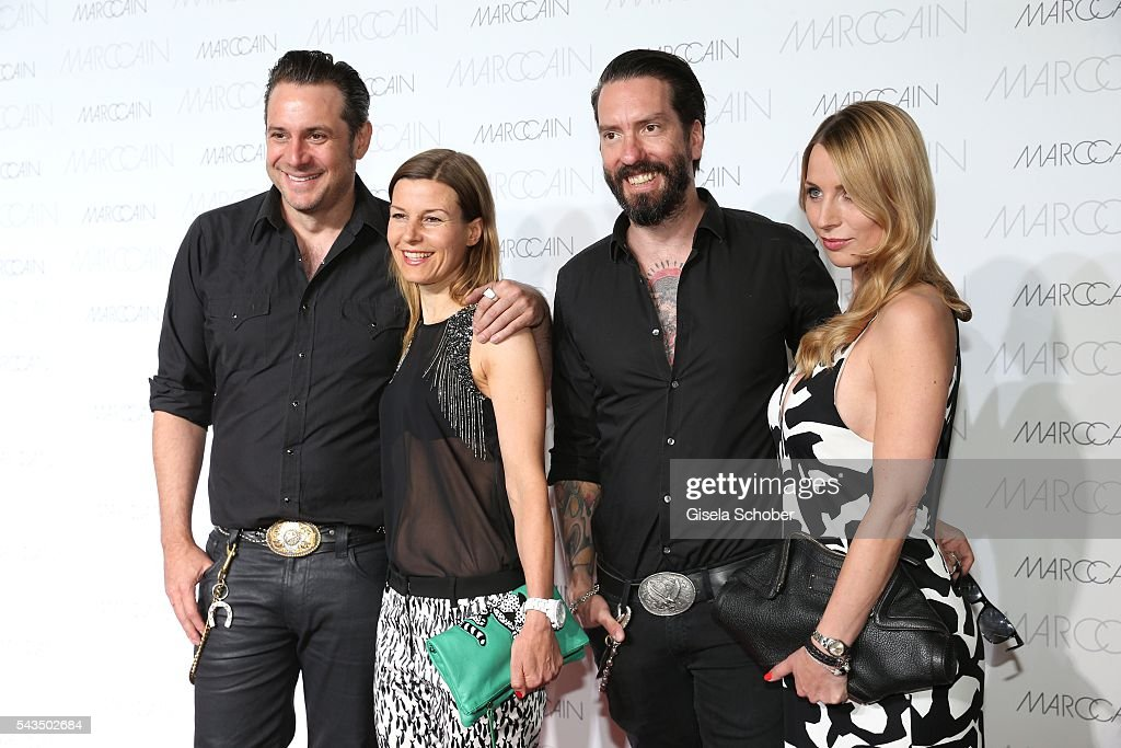 Sascha Vollmer, member of 'The Boss Hoss', and his girlfriend Jenny and Alec Voelkel,member of 'The Boss Hoss' and his wife Johanna Michels during the Marc Cain fashion show spring/summer 2017 at CITY CUBE Panorama Bar on June 28, 2016 in Berlin, Germany.