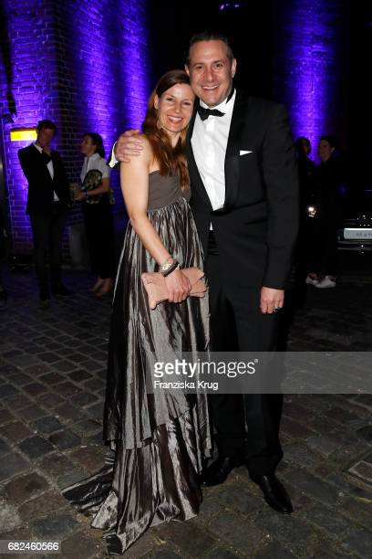 Sascha Vollmer member of 'The Boss Hoss' and his wife Jenny Vollmer during the GreenTec Awards at ewerk on May 12 2017 in Berlin Germany