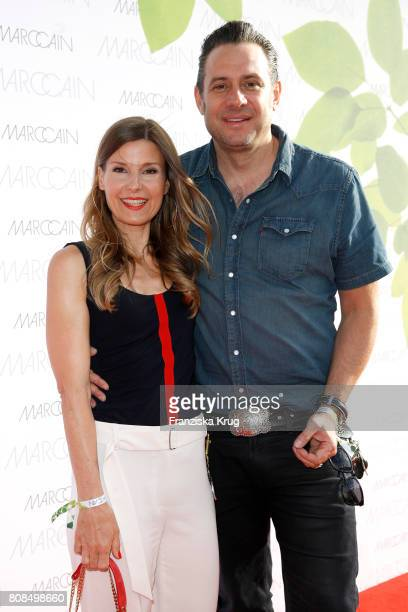 Sascha Vollmer member of 'The Boss Hoss' and his wife Jenny Vollmer attend the Marc Cain Fashion Show Spring/Summer 2018 at ewerk on July 4 2017 in...