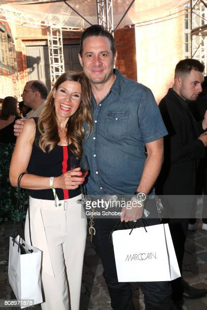Sascha Vollmer member of 'The Boss Hoss' and his wife Jenny Vollmer during the Marc Cain Fashion Show after show party Spring/Summer 2018 at ewerk on...