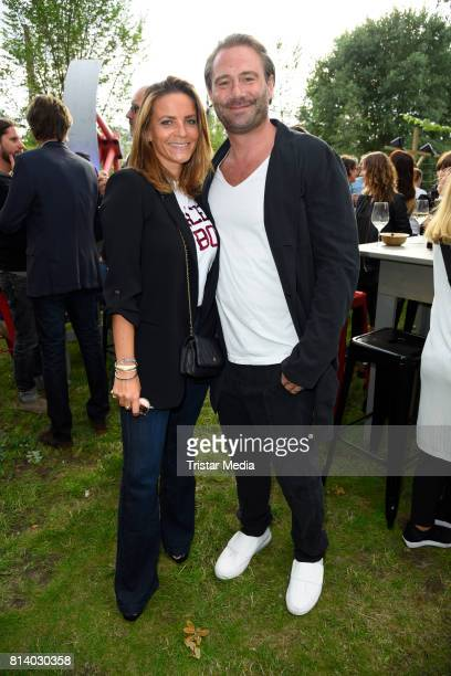 Sasha and his wife Julia Roentgen attend the 70th anniversary party of Budde Music on July 13 2017 in Berlin Germany