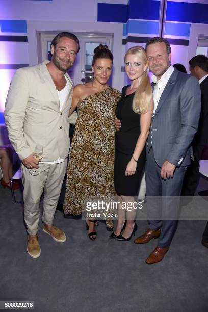 Sasha and his wife Julia Roentgen Jenke von Wilmsdorff and his wife Mia Bergmann attend the Bertelsmann Summer Party on June 22 2017 in Berlin Germany