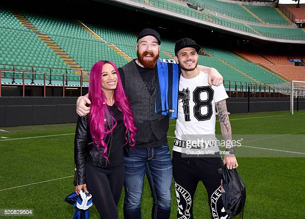Sasha Banks Sheamus and Mauro Icardi of FC Internazionale pose for a photo at Stadio Giuseppe Meazza on April 13 2016 in Milan Italy