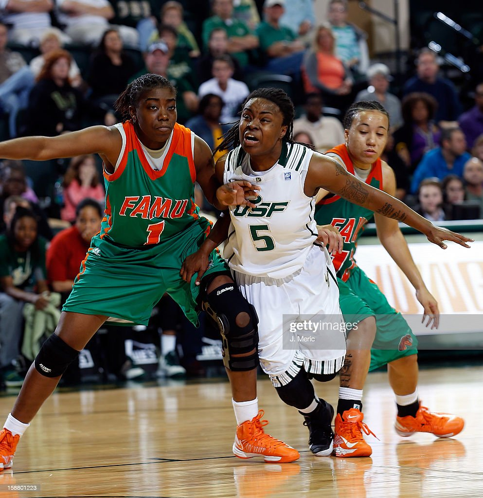 Sasha Bernard #5 of the South Florida Bulls battles Jaleesa Blue #1 of the Florida A&M Rattlers for a rebound during the game at the Sun Dome on December 29, 2012 in Tampa, Florida.