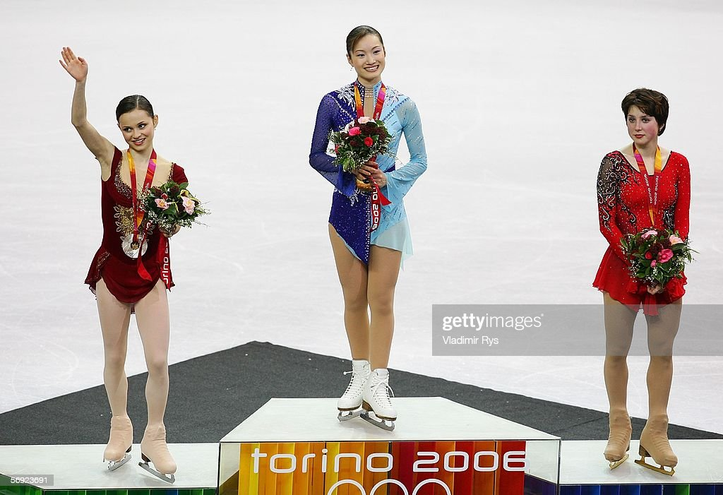 Sasha Cohen of the United States silver medal Shizuka Arakawa of Japan gold medal and Irina Slutskaya of Russia bronze medal pose on the podium after...
