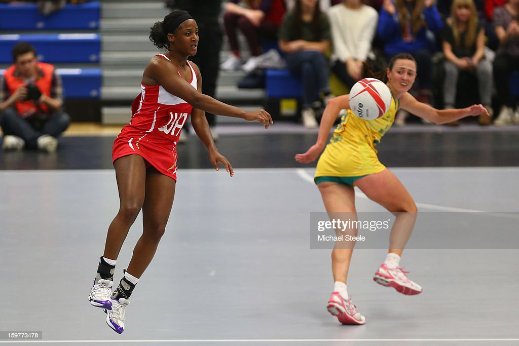Sasha Corbin (L) of England makes a pass during the England v Australia International Netball Series match at the University of Bath on January 20, 2013 in Bath, England.