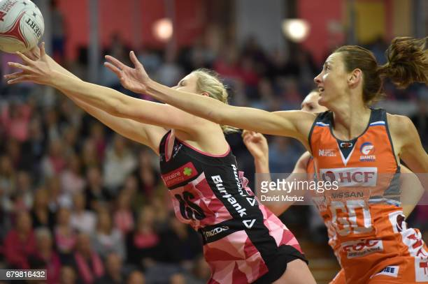 Sasha Glasgow of the Thunderbirds and Bec Bulley of the Giants during the round eleven Super Netball match between the Thunderbirds and the Giants at...