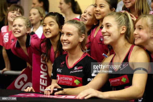Sasha Glasgow of the Thunderbirds signs autographs for fans during the round eight Super Netball match between the Thunderbirds and the Vixens at...