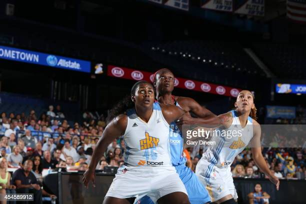 Sasha Goodlett and Courtney Clements of the Chicago Sky box out against Aneika Henry of the Atlanta Dream in Game Two of the Eastern Conference...