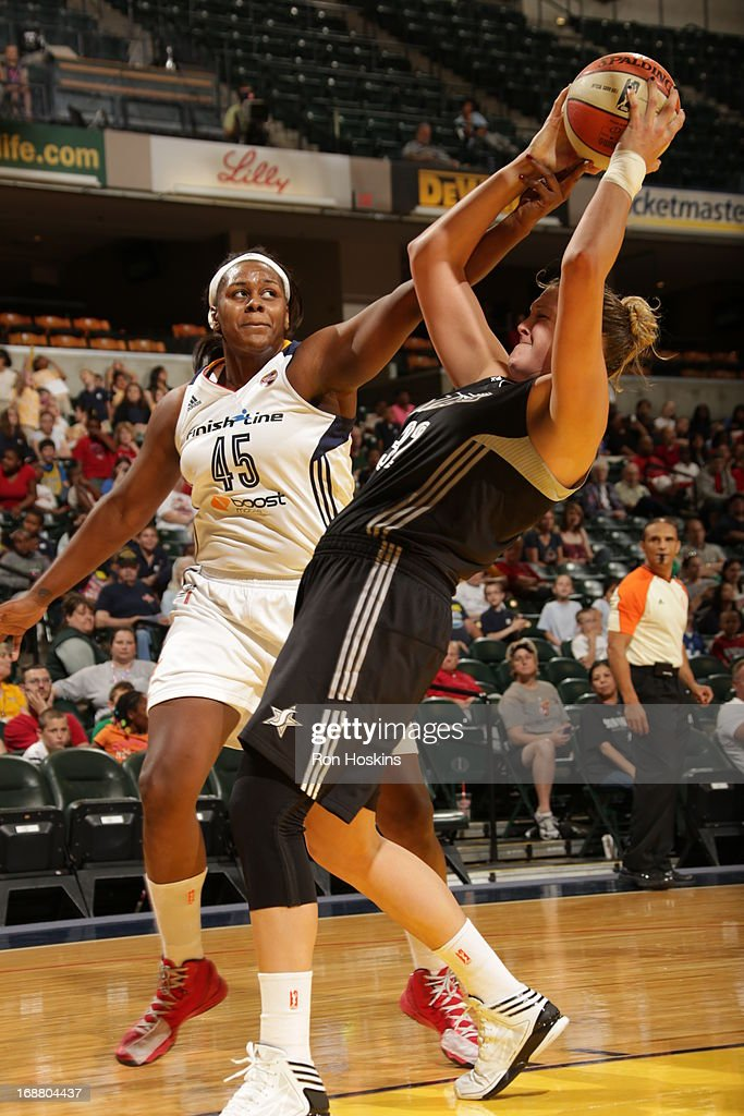 Sasha Goodlett #45 of the Indiana Fever battles Jayne Appel of the San Antonio Silver Stars on May 13, 2013 at Bankers Life Fieldhouse in Indianapolis, Indiana.