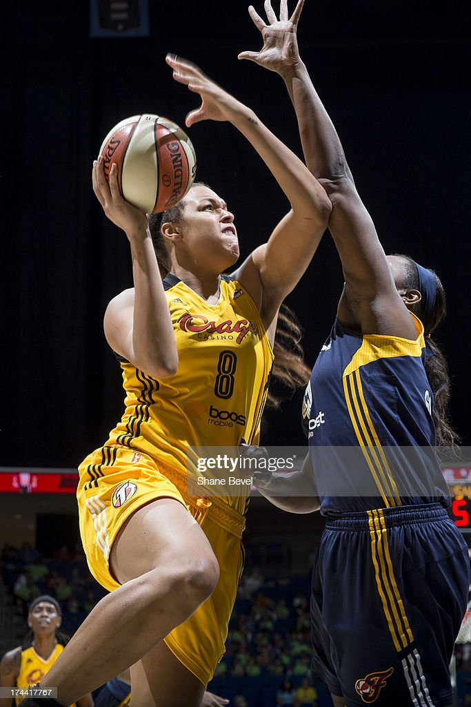 Sasha Goodlett # 45 of the Indiana Fever defends Elizabeth Cambage # 8 of the Tulsa Shock during the WNBA game on July 25, 2013 at the BOK Center in Tulsa, Oklahoma.