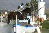 Sasha Harrison of Ireland and horse All Love Du Fenaud make a jump in the team three day eventing cross country competition on August 17 2004 during...