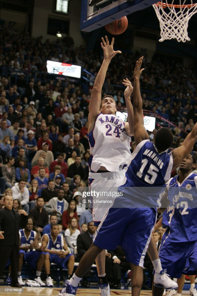Sasha Kann of the Kansas Jawhawks puts up a shot over Jacob Manning of the New Orleans Privateers during 1st half action at Allen Fieldhouse in Lawrence, Kansas on December 29, 2005. The Jayhawks won 73-56.