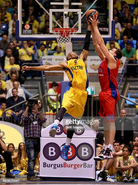 Sasha Kaun #24 of CSKA Moscow competes withAlex Tyus #9 of Maccabi Electra Tel Aviv in action during the 20132014 Turkish Airlines Euroleague Top 16...